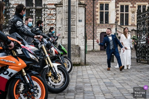A top wedding photographer at the Orleans Town Hall captured this picture of the groom saying, Lets get louder to the motorcycle group