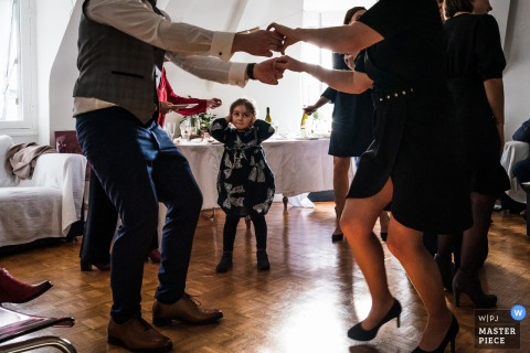 A wedding photographer in Orleans created this image of a Loud Dance moment indoors at the small reception