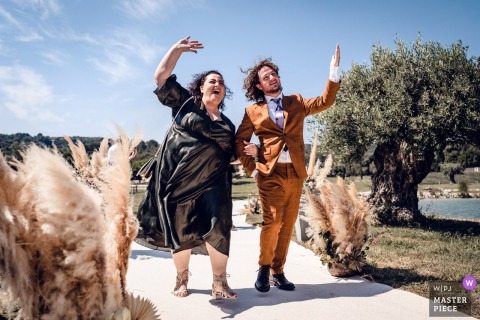 Les Domaines de Patras best wedding photography from Solerieux showing a pic ofbrother and aunt approaching the aisle of the outdoor ceremony