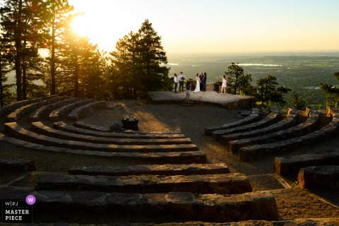 Colorado best wedding photography from Boulder showing a pic ofA couple and their close family members shaing their vows in private at sunrise