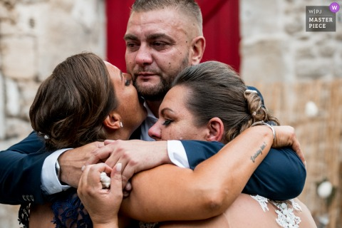 Best wedding photography from France showing a pic of Sisters and brother in arms
