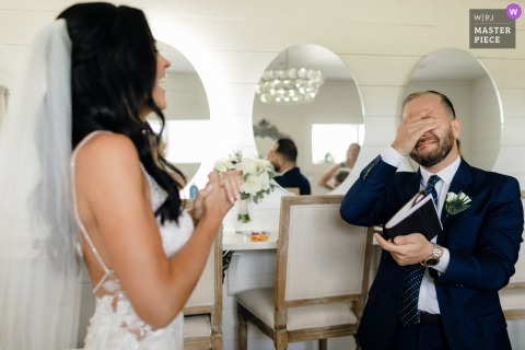 A wedding photographer in Chicago created this image ofthe  Officiant and Brides best friend seeing her for the first time