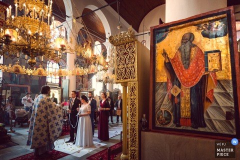 Best wedding photography from Bulgaria showing a pic ofan indoor church ceremony