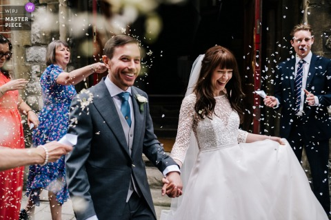 A top wedding reportage photographer at Christchurch Mayfair in London captured this picture ofa festive Confetti shot