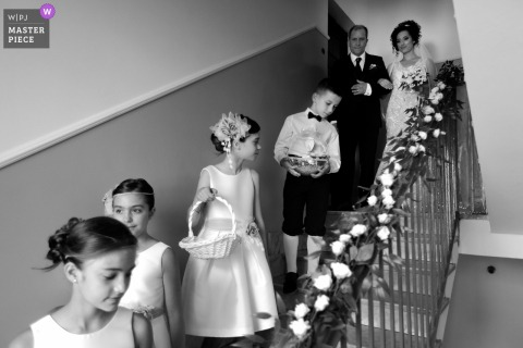 Calabria best wedding photography from Soriano Calabro showing a pic of the bridal party Starting towards the church