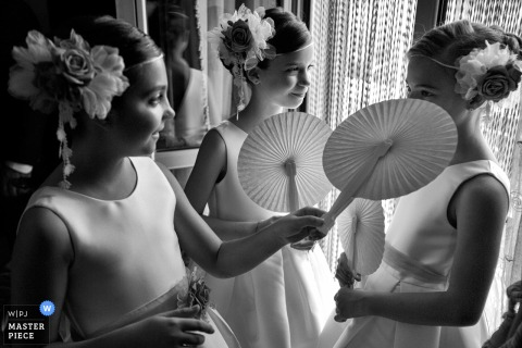 A top wedding photographer in Soriano Calabro, Calabria captured this picture of The bridesmaids at the grooms house