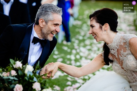 An Italian wedding photographer at Castello di Torre Alfina created this image ofThe bride and groom during the ceremony and the tears of emotion