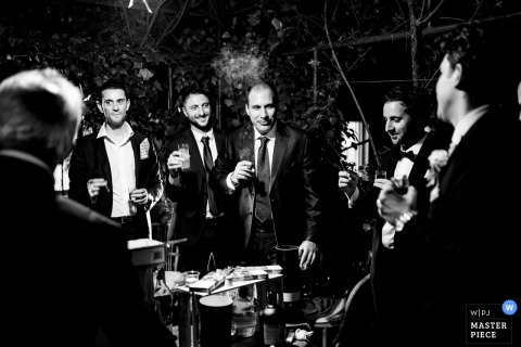 A top wedding photographer at Villa Pocci in Rome captured this picture ofThe groomsman during the reception