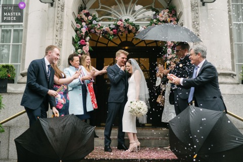 A top UK wedding photographer at the Chelsea Old Town Hall in London captured this picture of confetti tossed at bride and groom outside the hall