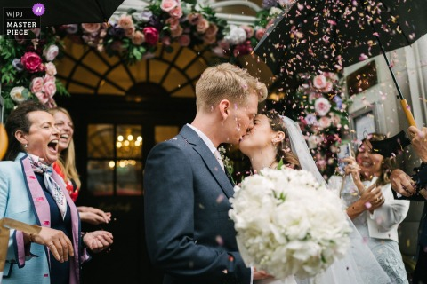 A London wedding photographer in Chelsea Old Town Hall created this image ofA confetti moment outside of the Town Hall