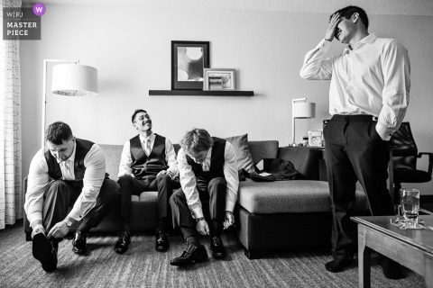 Best wedding photography from Waterloo Village in New Jersey showing a pic of Groom and groomsmen laughing during groom prep