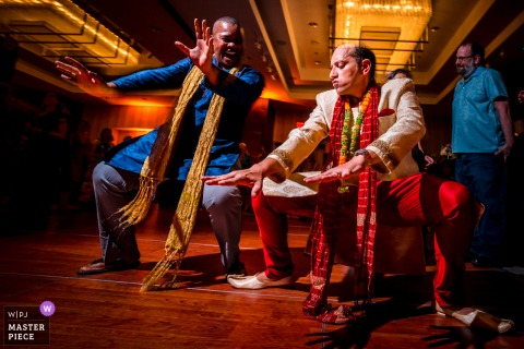 Best wedding photography from Marriott Metro Center in DC showing a pic ofThe groom and his best man dancing