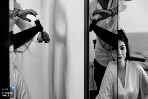A top Istanbul wedding photographer at the Divan Hotel captured this picture ofBride is getting ready with her reflection on the mirror