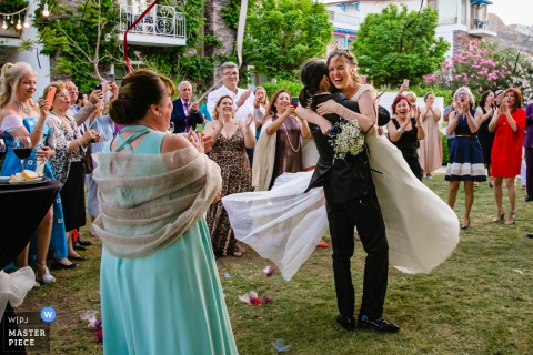 A top wedding photographer in Bodrum Villamaçakızı hotel captured this picture ofthe Groom hugging the bride and the groom turns her around