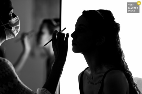 Best wedding photography from Vendee showing a pic showing a Slihouette of the Bride having her make up done