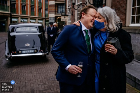 Best wedding photography from Netherlands showing a pic of the groom with his mother after ceremony