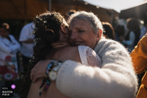 Quiberon, France wedding photography showing a Hug between the bride and her grand mother