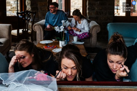 A cottage in Yorkshire, UK wedding reportage photography showing The bride and her bridal party get ready on a busy wedding morning