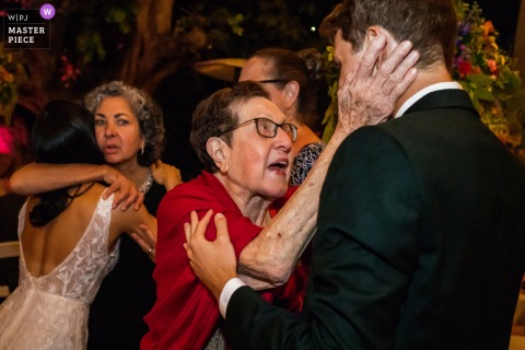 The Lombardi House, Los Angeles, California wedding photography showing Family relatives give their best wishes to the newlywed before leaving the reception