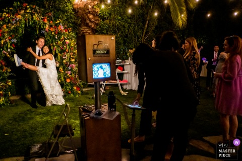 The Lombardi House, Los Angeles, California wedding photography showing  The newlywed enjoys a photobooth during their wedding reception