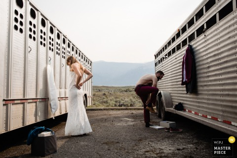 Lamar Valley, Yellowstone marriage preparation time award-winning picture capturing the elopement couple getting ready together. The world's best wedding image competitions are held by the WPJA