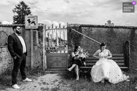 Couches, France nuptial day award-winning image of a Funny scene. The world's best wedding photography competitions are hosted by the WPJA
