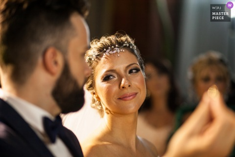 Allegro Buffet indoor marriage ceremony award-winning image showing the brides look. The world's best wedding picture competitions are featured via theWPJA