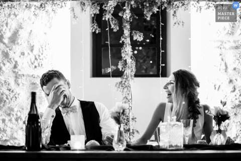 Château Saint Denis, France indoor wedding reception party award-winning picture showing BW laughs at the head table