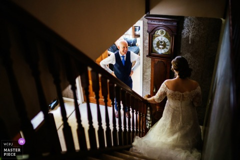 Whitchurch, UK marriage preparation time award-winning picture capturing the father of the bride sees his daughter in her wedding dress. The world's best wedding image competitions are held by the WPJA