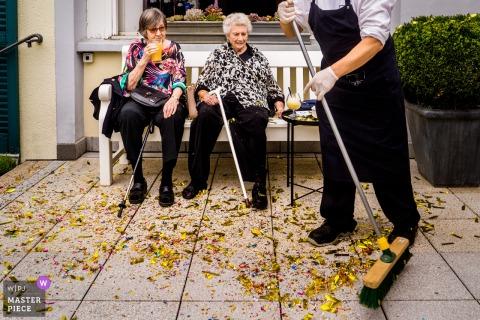 Frankfurt nuptial day award-winning image of Confetti mess and resting grandmas