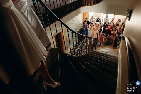 Chateau des Chézeaux - Indre nuptial day award-winning image of bride coming down to join guests downstairs