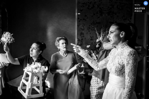 Lazio marriage preparation time award-winning picture capturing the Bride is getting ready while many things happen around her