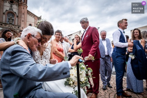 Carmaux Town Hall outdoor marriage ceremony award-winning image showing an emotional moment between the bride and her grandpa after the ceremony. The world's best wedding photo contests presented by the WPJA