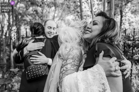 Kehoe House, Savannah, Georgia nuptial day award-winning image of Double hug in black in white outdoors