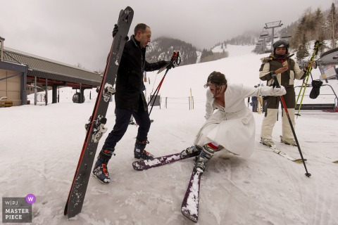 Aspen Mountain Resort nuptial day award-winning image of The bride falling down after skiing down the mountain following their micro wedding ceremony