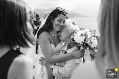 Lake Maggiore, Italy outdoor marriage ceremony award-winning image showing the Bride hugging her grandmother