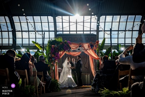 Garfield Park Conservatory, Chicago indoor wedding reception party award-winning picture showing a ceremony in a greenhouse