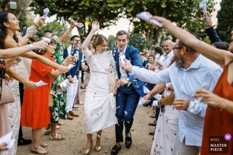 Provence Mas d'Arvieux outdoor marriage reception party award-winning photo that has recorded the Entering of the bride and groom