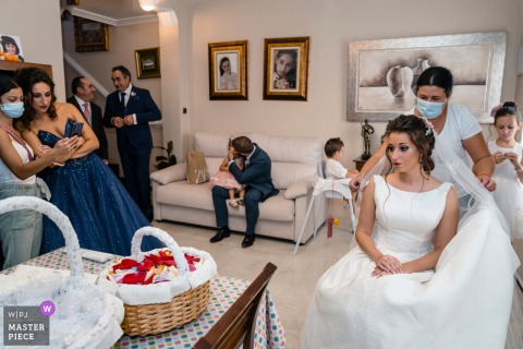 Jaén, Spain marriage preparation time award-winning picture capturing bride Getting ready in crowded room