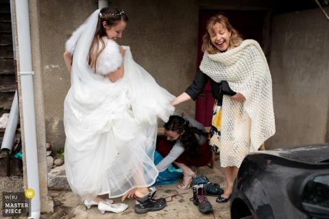Pont de la Mariée marriage preparation time award-winning picture capturing The bride changes her wedding shoes for walking boots