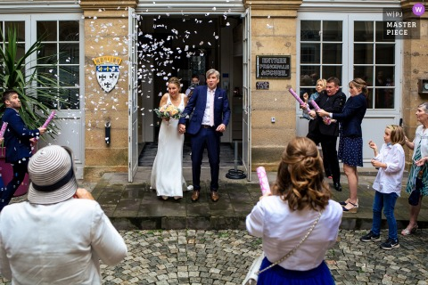 Mairie de Moulins nuptial day award-winning image of The exit of the town hall under the rain of confetti and the scary cannons