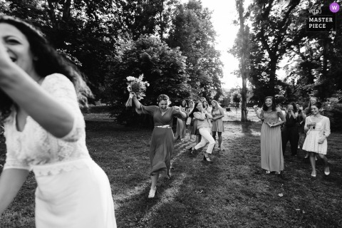 Beaujolais outdoor marriage reception party award-winning photo that has recorded the bouquet game in BW. The world's top wedding photographers compete at the WPJA
