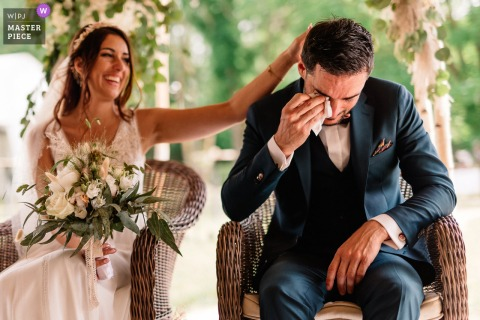 Auvergne outdoor marriage ceremony award-winning image showing the Groom crying during the ceremony. The world's best wedding photo contests presented by the WPJA