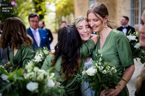 Biarritz outdoor marriage ceremony award-winning image showing congratulations time. The world's best wedding photo contests presented by the WPJA