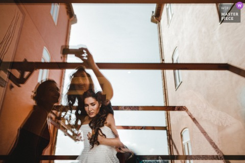 Porto, Portugal marriage preparation time award-winning picture capturing the bride reflections in glass windows. The world's best wedding image competitions are held by the WPJA