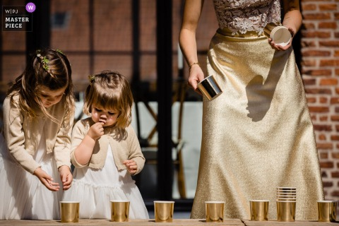 't Goed Indoye wedding reception party award-winning picture showing flower girls with golden cups. The world's most skilled wedding photographers are members of the WPJA