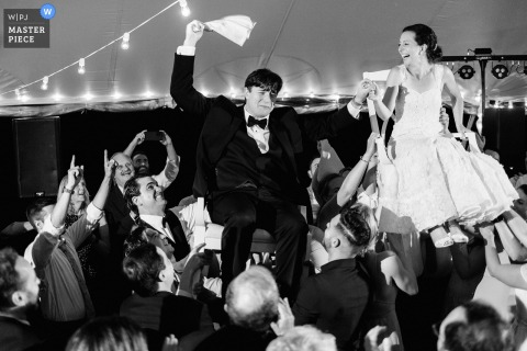 Elm Bank, Wellesley, MA outdoor marriage reception party award-winning photo that has recorded an exciting horah dance. The world's top wedding photographers compete at the WPJA