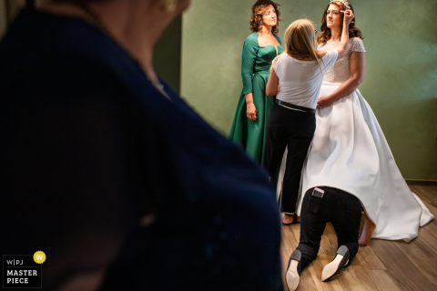 Siena marriage preparation time award-winning picture capturing the bride getting ready. The world's best wedding image competitions are held by the WPJA