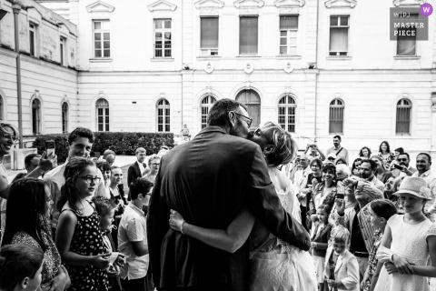 Ardeche nuptial day award-winning image of a Kiss at exit in BW. The world's best wedding photography competitions are hosted by the WPJA