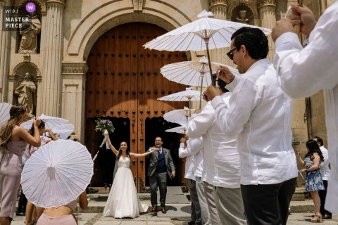 Santo Domingo Church, Oaxaca City marriage award-winning image showing the couples Ceremony exit. The world's best wedding photo contests presented by the WPJA